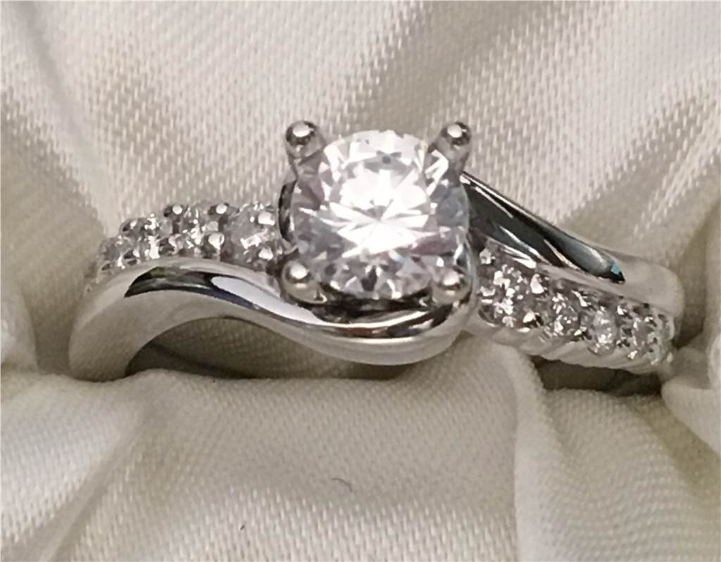 Diamond 14k White Gold Semi Mount Engagement Ring containing 0.25 twt side Diamonds mounting will accommodate a 1/2 Ct Round Stone