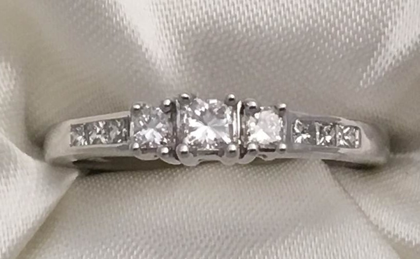 1/2 Ct twt, 14k White Gold Diamond Engagement Ring containing nine 0.50 twt Princess-cut Diamond