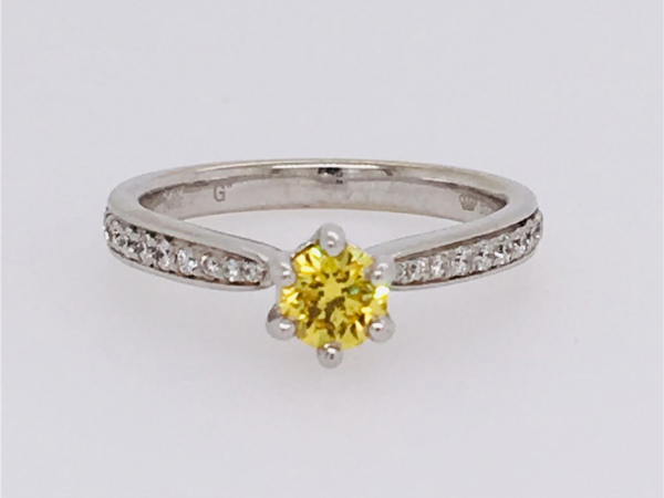 2/3 Ct Twt, 14K White Gold Diamond Engagement Ring  Containing One 0.38Ct Round Fancy Yellow Diamond & 0.24Ct Side Diamonds