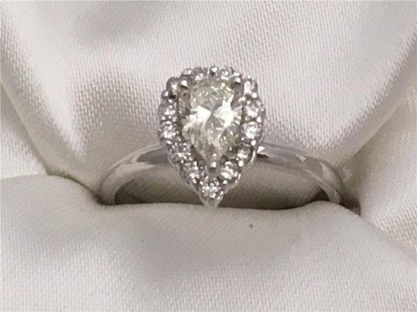 3/4 Ct twt, 14k White Gold Pear Shaped Halo Diamond Ring containing One Pear Cut Diamond, 0.55 Ct, Color K, Clarity VS1 0.75 twt of Diamonds
