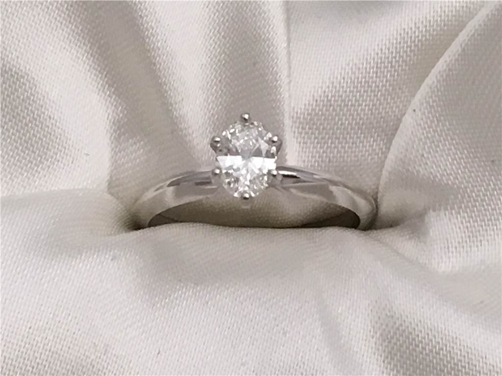 1/2 Ct, 14k White Gold Oval Diamond Solitaire Ring containing One Oval Diamond, 0.45 Ct, Color F,  Clarity VS1