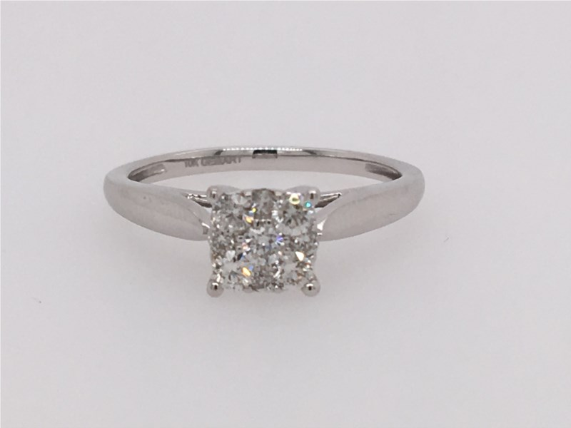 This Ring Looks Like 1.25 Carat Diamond! It is a White Gold Princess Diamond Ring that contains 1/3 ct twt of Diamonds in 10k..