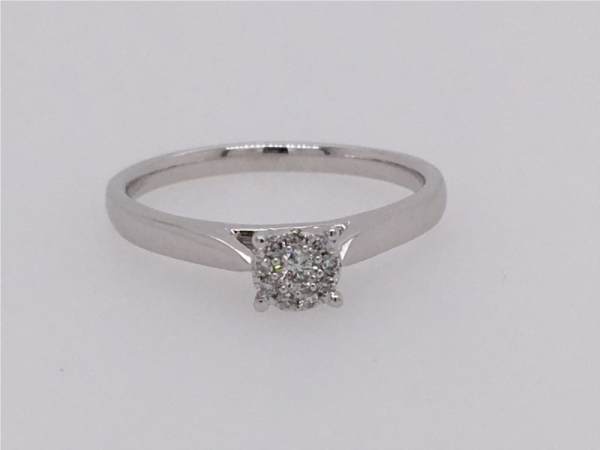 This Ring Looks Like 0.50 Carat Diamond! It is a White Gold Diamond Ring that contains 1/10 ct twt of Diamonds in 10k..