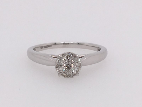 This Ring Looks Like 1.00 Carat Diamond! It is a White Gold Round Diamond Ring that contains 1/3 ct twt of Diamonds in 10k..