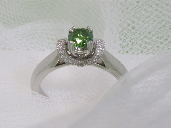 3/5 Ct twt, 14k White Gold Diamond Ring  containing One 0.47 Ct Irradiated Green Diamond, 0.58 twt